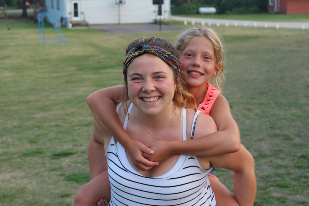 counsellor piggy backing camper
