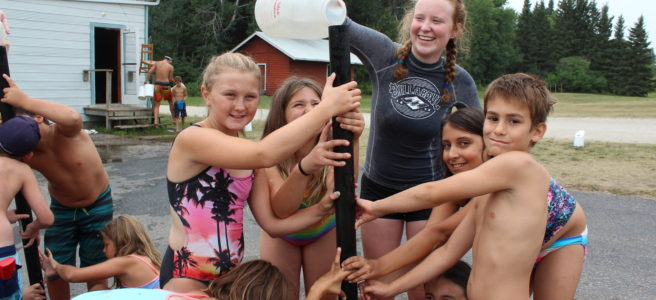counselor bailey leads a water game